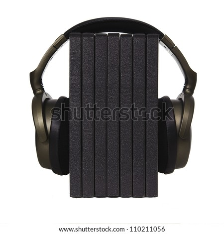 Listening to music concept with dvd boxes isolated - stock photo
