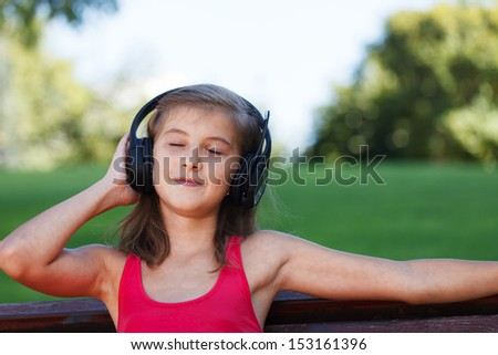 Listening To Music Outside - stock photo