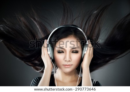 Listening to the music that makes hair fluttering.  - stock photo