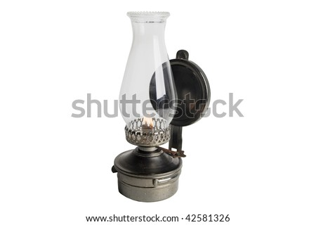 Lit Antique oil lamp isolated on white - stock photo