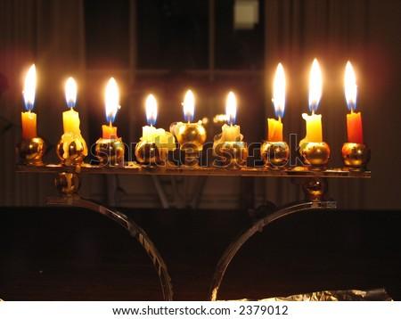 Lit Chanukah menorah on the 8th night. - stock photo