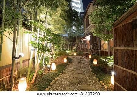 Lit gravel walkway at a Japanese Restaurant - stock photo