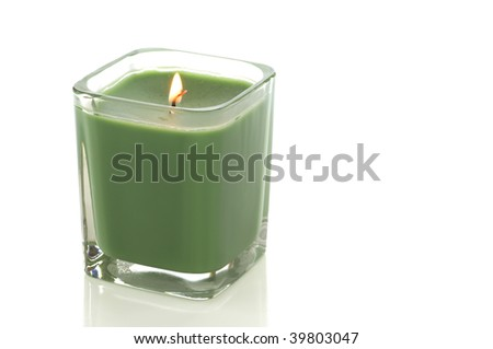 Lit green candle isolated on white with clipping path - stock photo