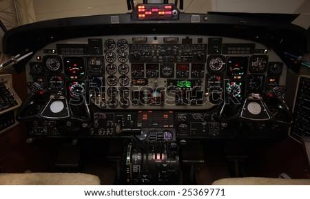 Lit instrument-panel of a Beech 1900D - stock photo