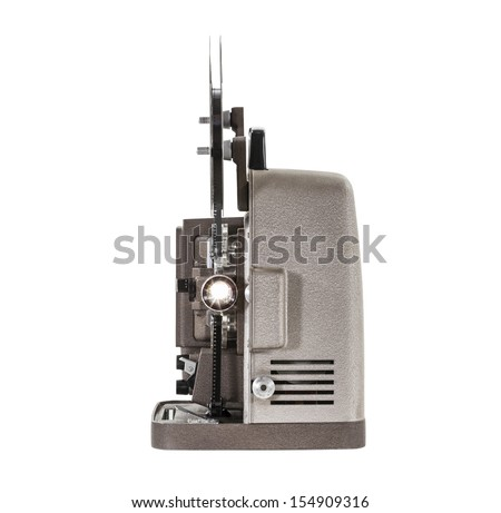 Lit vintage movie film projector isolated with clipping path. - stock photo
