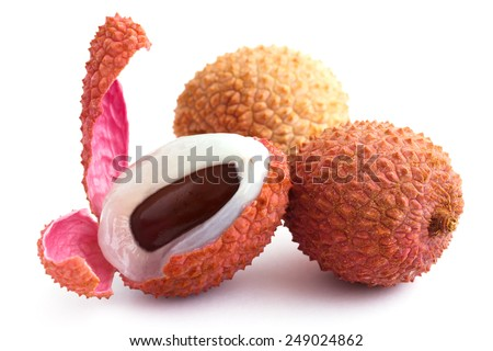 Litchis with pip, skin, and flesh. On white. - stock photo