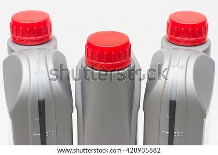 Liter bottle of oil for the engine or canister special automotive fluids. Horizontal photo - stock photo