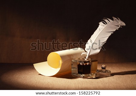 Literature Symbol. Old inkstand near scroll on canvas background - stock photo