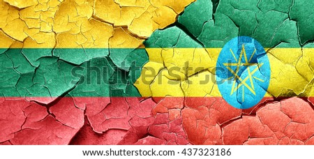 Lithuania flag with Ethiopia flag on a grunge cracked wall - stock photo