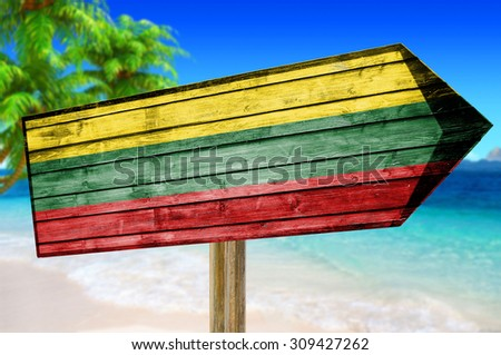 Lithuania Flag wooden sign on beach background - stock photo