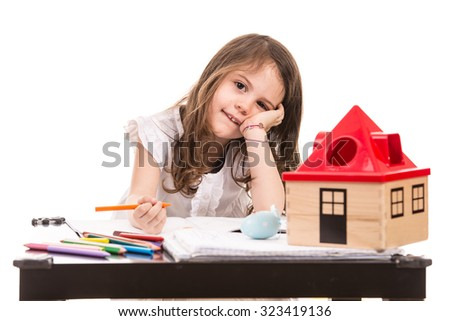 Litle girl at kindergarten sitting at table with pencils isolated on white background - stock photo
