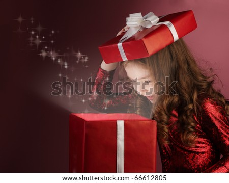 litle girl open red gift box - stock photo