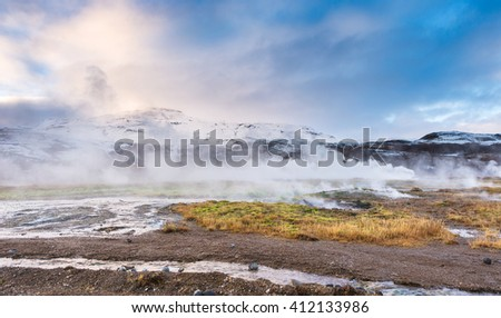 Litli Geysir, Geyser in Iceland. Winter cold colors, sun lighting through the steam - stock photo