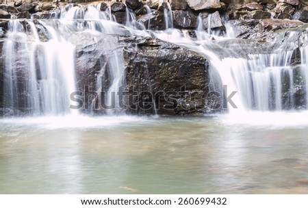 litlle waterfall in the forest - stock photo