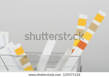 Litmus strips for measurement of acidity - stock photo