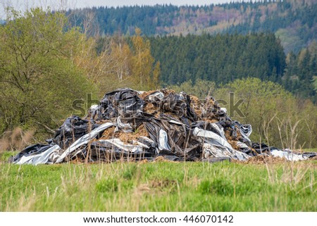 Litter waste rubbish garbage dirty plastic material dump pile ground forest nature background  - stock photo