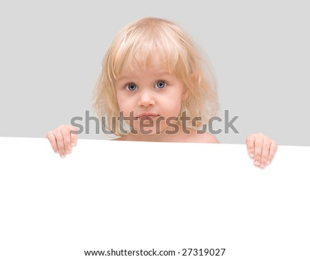 Littl girl holding a white poster