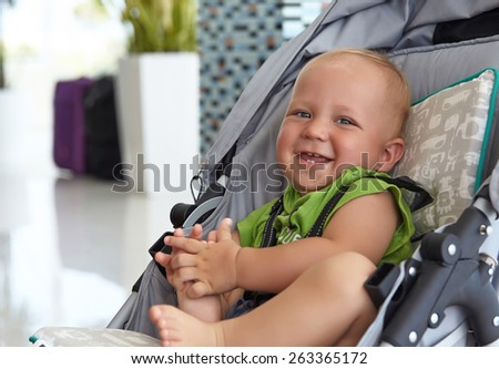 Little adorable baby boy in a stroller - stock photo