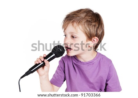 little adorable boy singing in a studio isolated