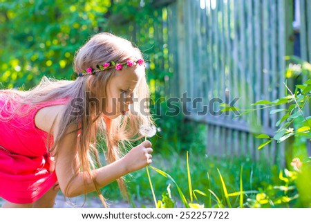 Little adorable girl during summer vacation - stock photo
