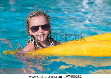 Little adorable girl enjoy in the swimming pool