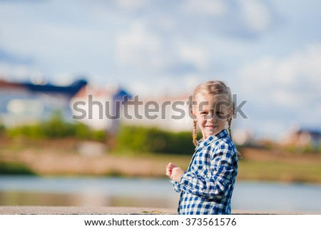 Little adorable girl outdoors at summer time on european vacation - stock photo