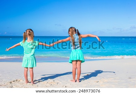 Little adorable girls during tropical summer vacation - stock photo