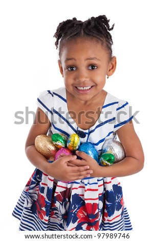 Little african american girl holding chocolate easter eggs, isolated on white background - stock photo