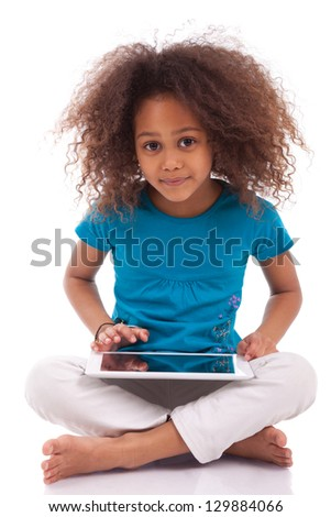 Little african asian girl using a tablet  pc, isolated on white background - stock photo