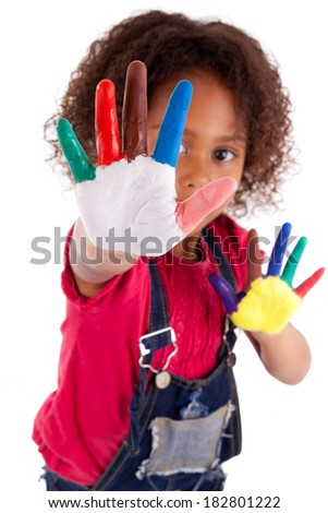 Little African Asian girl with hands painted in colorful paints - stock photo