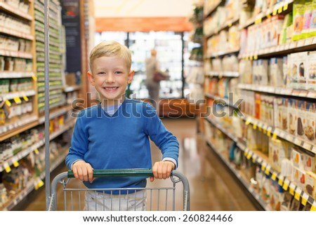 little and proud boy helping with grocery shopping, healthy lifestyle concept - stock photo