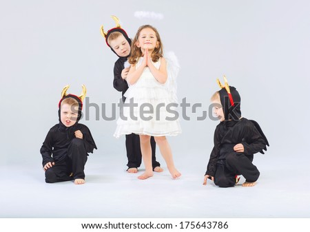 Little angel and devils - stock photo