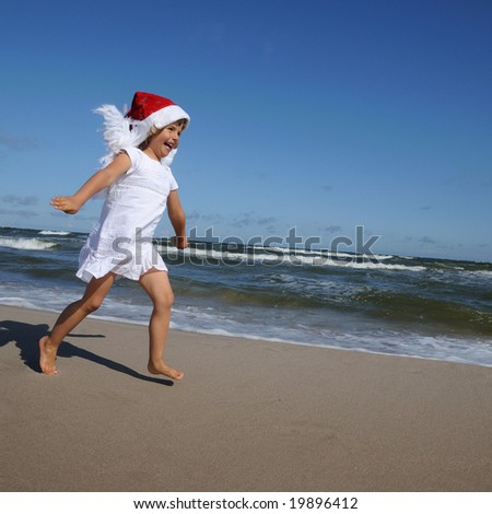 Little Angel on the beach - stock photo
