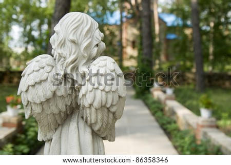 little angel sculpture in a city park - stock photo