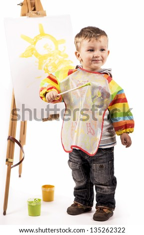 Little artist draws - stock photo