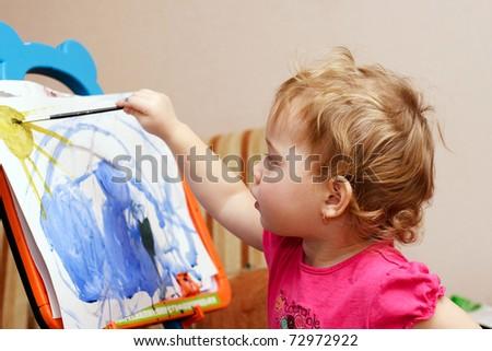 little artist is painting - stock photo