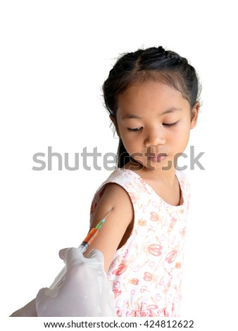 little asia girl looking at her arm, while receiving vaccine, , vaccination - stock photo