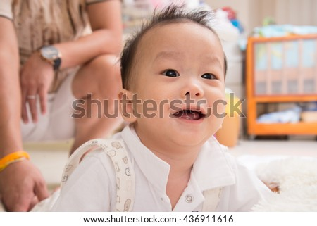 Little asian baby boy smiling with happy face