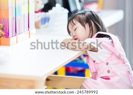 little asian boy play slide to the pool - stock photo