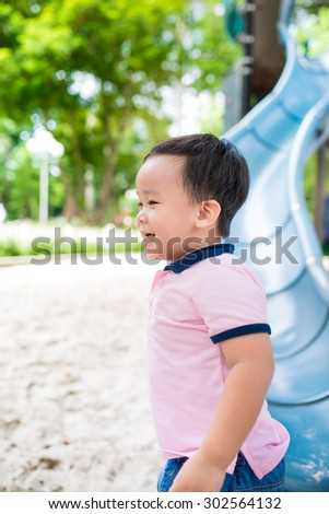 Little asian boy playing on the playground - stock photo