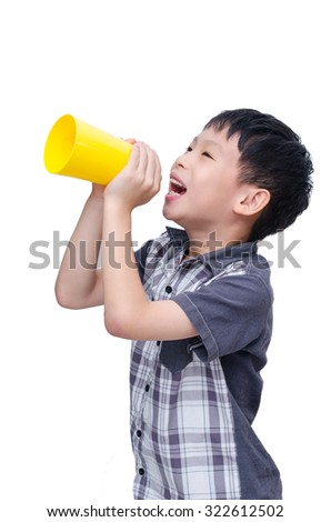 Little asian boy speaking via yellow cup over white