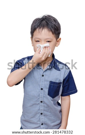 Little Asian boy wipes his nose by tissue paper over white background - stock photo