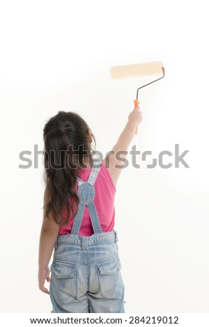 Little Asian child painting the wall on isolated back ground - stock photo