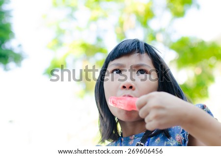 Little Asian girl enjoy her icecream - stock photo
