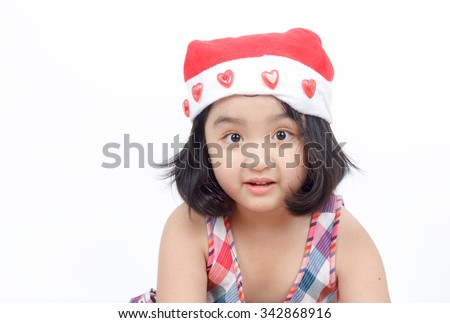 little Asian girl in Santa hat
