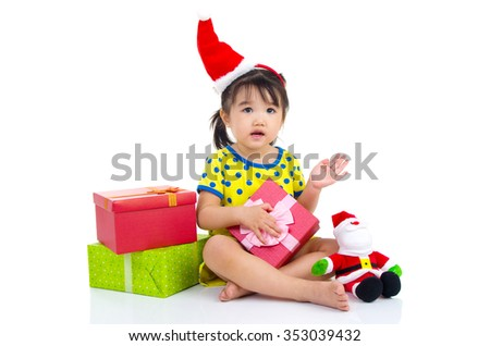 Little Asian girl in Santa hat and Christmas gift box isolated on white - stock photo