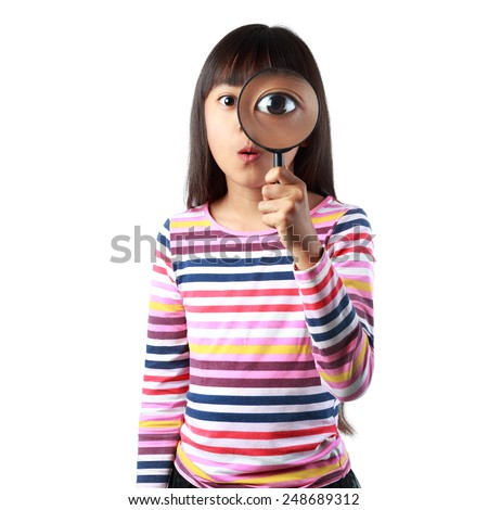 Little asian girl looking through a magnifying glass, Isolated over white - stock photo