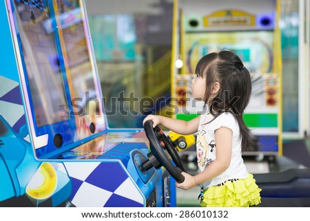 little asian girl play video game - stock photo