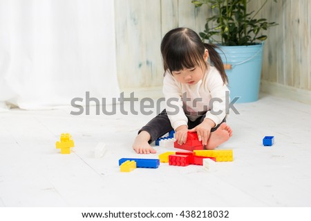little asian girl playing - stock photo