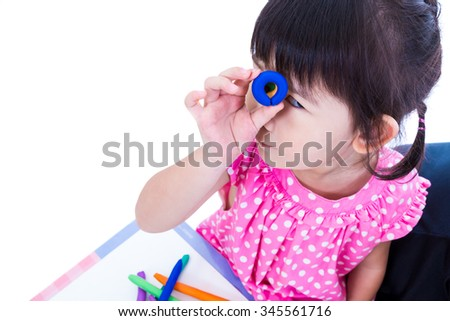 Little asian girl playing and creating toys from play dough. Child show her works from clay, over white background. Strengthen the imagination of child - stock photo